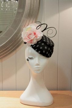 Black and white polka dot sinamay fascinator with pink rose and black quill accents - perfect for Melbourne cup!