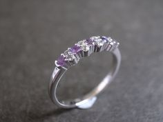 Hey, I found this really awesome Etsy listing at https://www.etsy.com/listing/115305261/amethyst-and-white-sapphire-wedding-ring