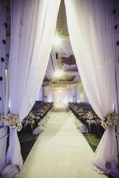 Amazing ceremony setup. Decor by The Garden Gate & Fauxcades. Photo by f8 Studio. #wedding #altar #winter #white