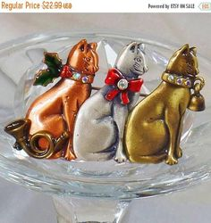 This  #vintage mixed metal Christmas cats brooch is just adorable!  It features a trio of cats, one copper, one pewter, and one brushed gold tone brass, each accented with a... #ecochic #etsy #jewelry #jewellery
