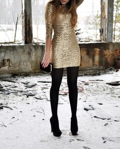 Gold sequined mini dress with black tights and shoes