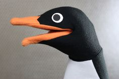 The final installment of our How To Make A Penguin Puppet tutorial is short and sweet, just like a penguin. We will apply the finishing touches: mouth plates, eyes, and foam padding for the head.