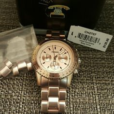 Fossil Watch This watch is practically brand new. I've worn it 1x and it's been cased ever since. It does need a battery, but that's the only thing! Perfect rose color. Only reason why I'm selling is because I have way too many watches!! Fossil Accessories Watches