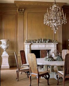 The Style Saloniste: May 2010.  Dining Room with wood and fireplace.