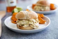 Suizas Style Pulled Chicken Sandwiches Pulled chicken sandwiches with a Mexican and Swiss twist! These Suizas Style Pulled Chicken Sandwiches are made easy with shredded chicken, making this a 20 minute dinner recipe. Shredded Chicken Sandwiches, Sandwich Recipes, Pork Chops, Salmon Burgers, Easy, Clean Eating, Dinner Recipes, Favorite Recipes, Recipe Chicken