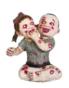 Double Trouble Zombie Baby- New for 2014 and Spirit Halloween exclusive! Double trouble has taken on a whole new meaning with the Double Trouble Zombie Baby. These zombie twins are the perfect gruesome addition for your Halloween scene. Features twin zombie babies with oozing bite marks. Bring this deadly duo home for $39.99!