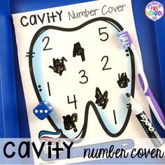 Tooth cavity number game! Dental health themed activities and centers for preschool, pre-k, and kindergarten (FREEBIES too) #dentalhealththeme #preschool #pre-k #tooththeme