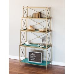 This tall shelf unit features 4 metal shelves. It has turquoise shelves with gold trim. The display shelves can be nested to save space when not in use.
