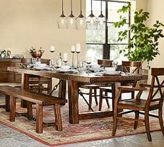 Chic Dining Room Features A Tray Ceiling Accented With Satin Nickel And Glass Chandelier Illuminating Dark Stained Curved Table Lined Wi