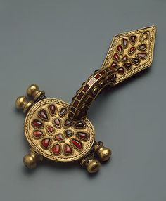 Fibula - Silver, gold and cornelian; forged, soldered and decorated with inlay. Goth Culture. Late 4th - early 5th century