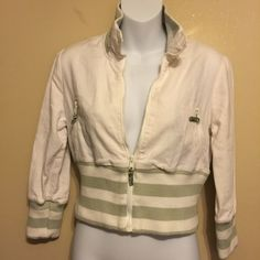 Free people jacket 100% cotton white waisted jacket . With a tight fitted stretch band . Has two zip pockets on front zips up front . 3/4inch sleeves . Band stretch collar . 18 in length sleeves . Jacket measures 18 inch length. Free people Jackets & Coats