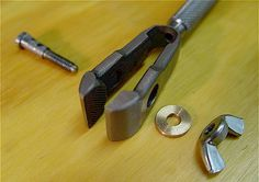 A hand vise designed to clamp long wire (Germany). The tightening screw & handle have clearance holes.