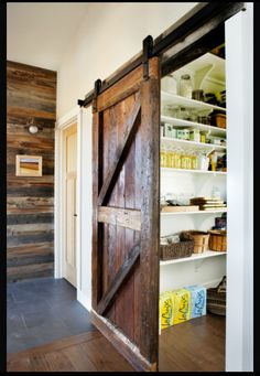 Basement, love the farm house doors...might be a better idea than pockets.