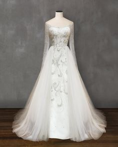 Custom made wedding dress with fluffy skirt and hand embroidery. Send us a photo of your dream dress and our experienced tailors will make it real.
