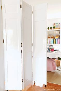 Look what you can do with bifold doors found at the thrift store. How to make a unique DIY rolling door to separate two rooms for about $30.