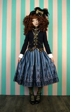 "elaborate pirate  Lolita.  ""Lolita"" fashion is the name for clothes worn by Japanese teenage girls, making them look like elaborately dressed little girl dolls."