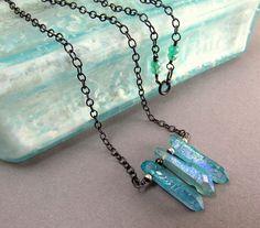 Aqua Aura Quartz Crystal and Sterling Silver Necklace Raw Crystal Necklace, Crystal Point.    Aqua aura quartz is a beautiful bright blue color...