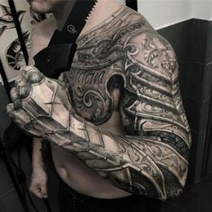 61 Best Stylish, Beautiful and Unique Tattoos for Men unique tattoos for men; unique tattoos for couples; unique tattoos for my son; unique tattoos for lost loved ones; unique tattoos for parents; unique tattoos for best friends Armor Sleeve Tattoo, Armour Tattoo, Shoulder Armor Tattoo, Best Sleeve Tattoos, Tattoo Sleeve Designs, Body Armor Tattoo, Mens Full Sleeve Tattoo, Shoulder Sleeve, Man Sleeve Tattoo Ideas