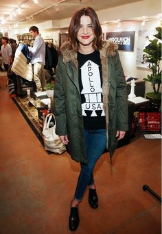 Cobie Smulders at Sundance in an army green parka and Coach sweater