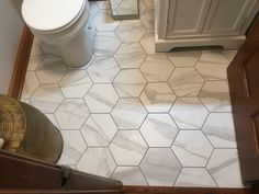"Notice how the size of this hexagon tile visually opens up the space in this small powder room.  Call us with Questions: 865.329.3290  (V468RO-COL-STA- 10"" Porcelain Hexagon Tile."