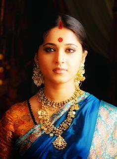 Anushka Shetty Cute Stills In Blue Saree - Anushka Shetty