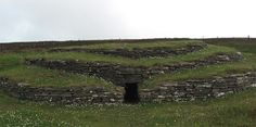 The Three-Concentric Circular Layers of the Wideford Hill Chambered Cairn, Mainland, Orkney, Scotland.  Photo by J. Demetrescu 2010.| Built around 3,000 B.C. and sitting on the northwestern slope of Wideford Hill near Kirkwall, this Maeshowe-type structure is made up of three concentric circles. Before its earthen mound covering was removed, it is most likely to have resembled a dome in shape.