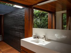 A private outdoor space connects the master bathroom with the home gym. The residence has TOTO fixtures (including Neorest Japanese toilets) and a property-wide water filtration system. Micro House Plans, Venice House, Clad Home, Build Your Own House, Upstairs Bedroom, Prefab Homes, Stone Flooring, Outdoor Rooms, Apartment Design