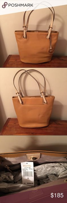 Michael Kors Purse Tan fine leather Michael Kors Purse with gold embellishments. Authentic. Brand new, never been used, still with tags. Michael Kors Bags Totes