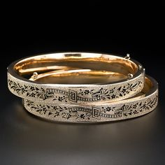 A superb pair of perfectly matched antique bangle bracelets in lovely textured 15 karat rosy-yellow gold (hence of British origin) adorned with all around black enamel ornamentation. Rings are in place to add safety chains if so desired. Circa 1875 and in excellent condition. $3850
