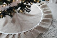 This DIY tree skirt will give your Christmas tree a natural yet dressed up look – and it involves no sewing.