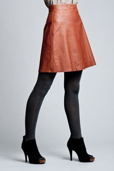 The leather skirt is nice. A bit short to my taste. And you know what I think about black/grey with brown. NO! The thick tights - or stockings... mmm... I'm not into sparkle though. Cut that. But the shoes... and the posture. Nothing to say about that, but YUM!!!