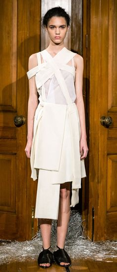 True to form, Phoebe English delivered another collection filled with textures and layers, including a choppy cream skirt with suspenders that bound the arms. (Photo: Miles Willis/Getty Images)