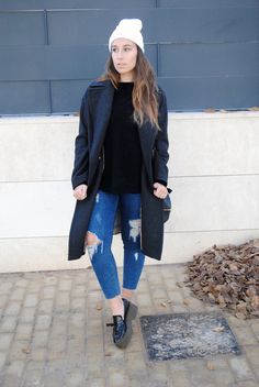 Shop this look on Lookastic:  https://lookastic.com/women/looks/coat-crew-neck-sweater-skinny-jeans-platform-loafers-beanie/7292  — White Beanie  — Charcoal Coat  — Black Crew-neck Sweater  — Blue Ripped Skinny Jeans  — Black Leather Platform Loafers