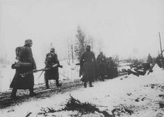 Wehrmacht soldiers and tanks Pz.Kpfw. I march on the road in Norway. 1940.