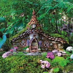 Fairy Houses 2017 Wall Calendar reveals a magical world of handcrafted castles and cottages, fanciful fairy retreats and sanctuaries, and habitable hobbit hideaways by Sally J. Click through to see the most recent edition! Fairy Tree Houses, Fairy Village, Fairy Garden Houses, Fairy Crafts, Garden Crafts, Garden Art, English Garden Design, Fairy Doors, Miniature Fairy Gardens