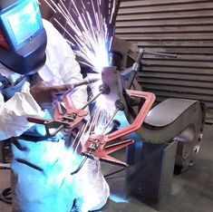 Welding the Paisley Bench. Polished stainless steel and oak bespoke handmade to order garden seating.
