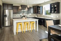 Kitchen with accent lighting, stainless steel appliances and glass cabinetry.