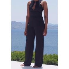 "Chèlbe 3-Way Black Jumpsuit  A Chèlbè twist on the classic black jumpsuit. Vary your style with the 3 way adjustable top.   37"" inseam Stretch Front-Zip detail  Adjustable top fastening hook"