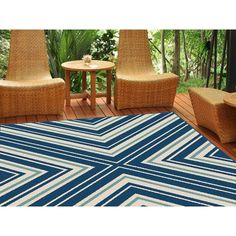 Arrange for a vacation at home with this symmetric chevron rug in statement colors. Weather-resistant polypropylene fibers keep this rug looking great for years to come. Perfect for an outdoor room or sunroom. This lively design is a foolproof addition to all types of decorating styles. Navy, cream and aqua color.