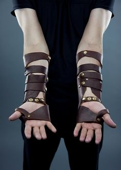 Custom Made Brown Leather Bracers. Cheap knock off with craft foam and brads from office store