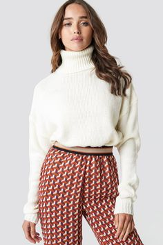 04a8aac3844 The Folded Oversize Shirt Knitted Sweater by NA-KD features a soft and  knitted design