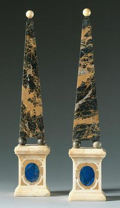 A pair of Italian neoclassical marble obelisks early 19th century each portor des Pyrénéees obelisk above a white marble pedestal inlaid with an oval panel of lapis lazuli. heights 21 in. 53.3 cm.