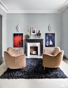 In the master bedroom of fashion designer Stefano Pilati's Paris duplex, colorful photographs by Jeff Burton flank the granite mantel, which is topped with a collection of objects.