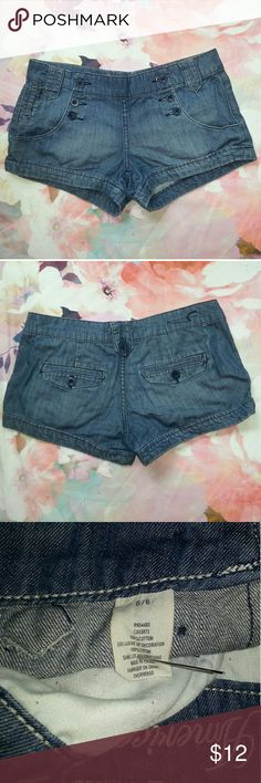 """AEO Rockabilly Button Flap Denim Short Shorts Excellent gently loved condition. No holes, stains, tears or other flaws, minor wash wearing visible.  Measurements laying flat Waist 16"""" Rise 8"""" Inseam 3""""  Feel free to ask any questions, request additional measurements or photos. Please submit offers through the offer button. My bundle discount is 15% off 2+!!  New items listed weekly! American Eagle Outfitters Shorts Jean Shorts"""