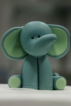 i need this cute little elephant in my room, along with many other animals <3