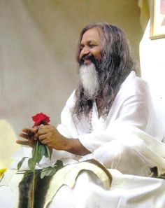 """""""Enjoy your life and be happy. Being happy is of the utmost importance. Success in anything is through happiness. More support of nature comes from being happy. Be happy, healthy, and let all that love flow through your heart.""""  --Maharishi, 1987"""