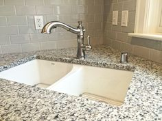 White Cast Iron Sink, Luna Pearl Granite, Desert Gray Subway tile and Delta Cassidy Collection Single-Handle Pull-Out Faucet in Arctic Stainless finish