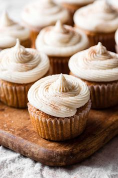 Apple Pie Surprise Cupcakes are fluffy fall inspired cupcakes made with an apple pie filling and maple buttercream. #applepie #applepiecupcakes #fallbaking #maplevanillafrosting #cupcakes #cupcakerecipe #twocupsflour