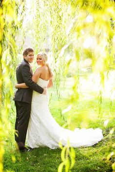 Gorgeous Photo of Bride in the Willow Tree by Mandy Blair Photography. The Wedding of Rachel & Jaron, A Family | Backyard Soiree Weddings and Events