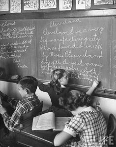 Fifth grader writing on the board in class. Ohio, 1946.